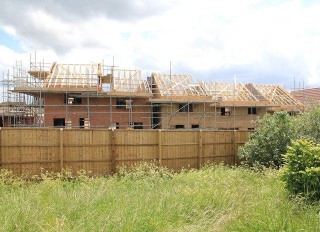 New Housing estate development perimiter wooden fencing